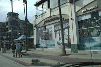 Person, Pedestrian, Traffic Light, Light, Road, Building, City, Urban, Town, Street, Downtown, Apparel, Clothing, Metropolis, Neighborhood