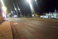 Lighting, Road, Building, Town, City, Street, Freeway, Path, Light, Flare, Highway, Plant, Suburb, Vegetation, Vehicle