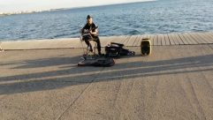 Water, Chair, Furniture, Waterfront, Dock, Port, Pier, Path, Musical Instrument, Musician, Sitting, Vehicle, Ocean, Sea, Road