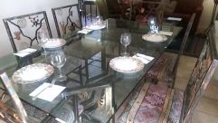Furniture, Table, Dining Table, Fireplace, Chair, Couch, Restaurant, Hearth, Coffee Table, Glass, Bird, Room, Meal, Food, Building