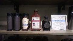 Shelf, Furniture, Bottle, Alcohol, Beverage, Drink, Wine, Jar, Wine Bottle, Cabinet, Beer, Camera, Electronics, Closet, Cupboard