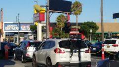 Vehicle, Automobile, Car, Wheel, Tree, Billboard, Arecaceae, Palm Tree, Parking, Parking Lot, Road, Suv, Sedan, Police Car, airplane