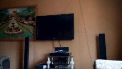 Display, Electronics, Monitor, Screen, TV, Television, Interior Design, LCD Screen, Entertainment Center, Stereo, Floor, Flooring, Art, Furniture, Shelf