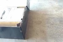 Furniture, Floor, Tabletop, Box, Chair, Flooring, Cardboard, Concrete, Vehicle, Carton, Electronics, Cushion, Table, Aluminium, Wood