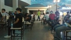 Furniture, Chair, Restaurant, Helmet, Crowd, Interior Design, Cafeteria, Cafe, Room, Audience, Meal, Food, Sitting, People, Table