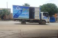 Vehicle, Truck, Automobile, Car, Plant, Tree, Wheel, Moving Van, Van, Town, Building, City, Arecaceae, Palm Tree, Bike
