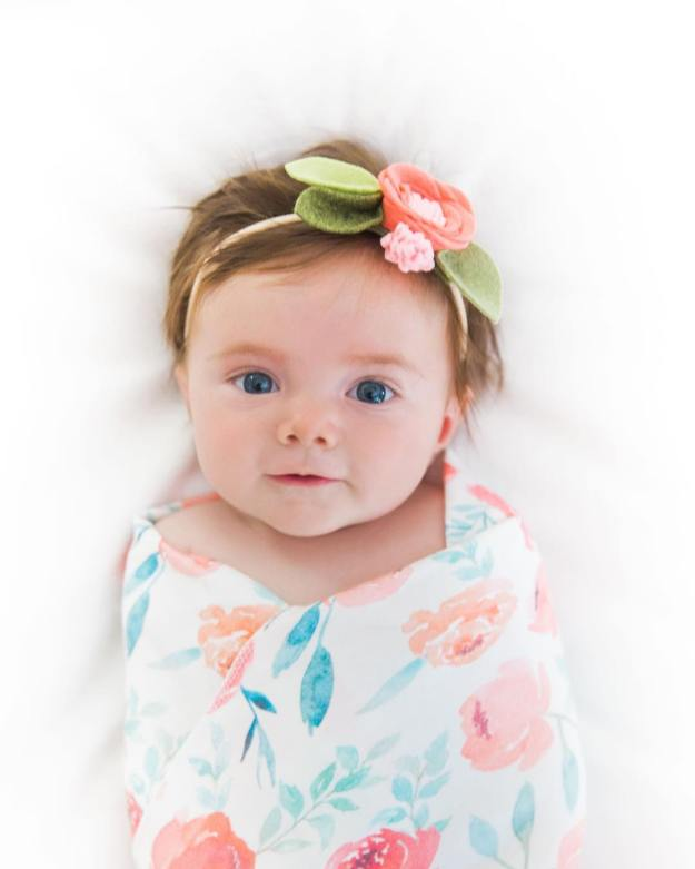 Flower power  Loving this bygeorgebabyboutique swaddle wrapped around littleemigirlhellip
