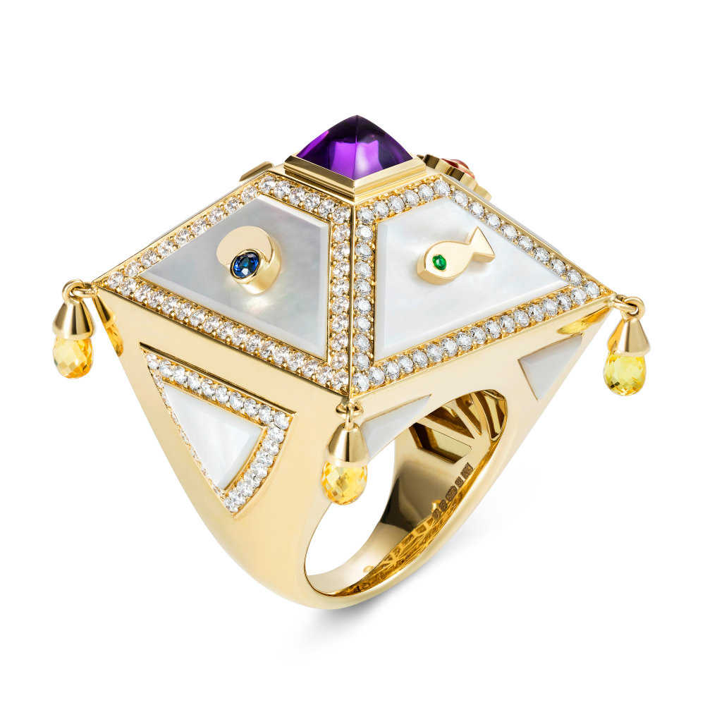 The Saga by Aisha Baker in 18K Yellow Gold with Enamel, Amethyst sugarloaf, Diamonds, Yellow Sapphire Briolette's, Pink Sapphire Cab, Emerald and Blue Sapphire ($23,000).