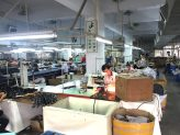 Workers in a hand bag factory