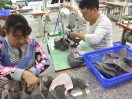 These workers stitch and assemble the upper parts