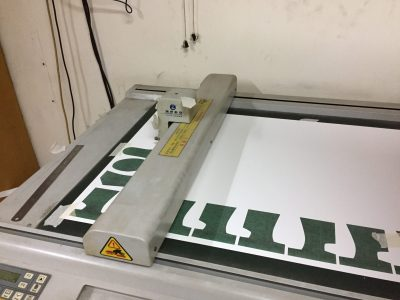Cutting a paper pattern for shoes