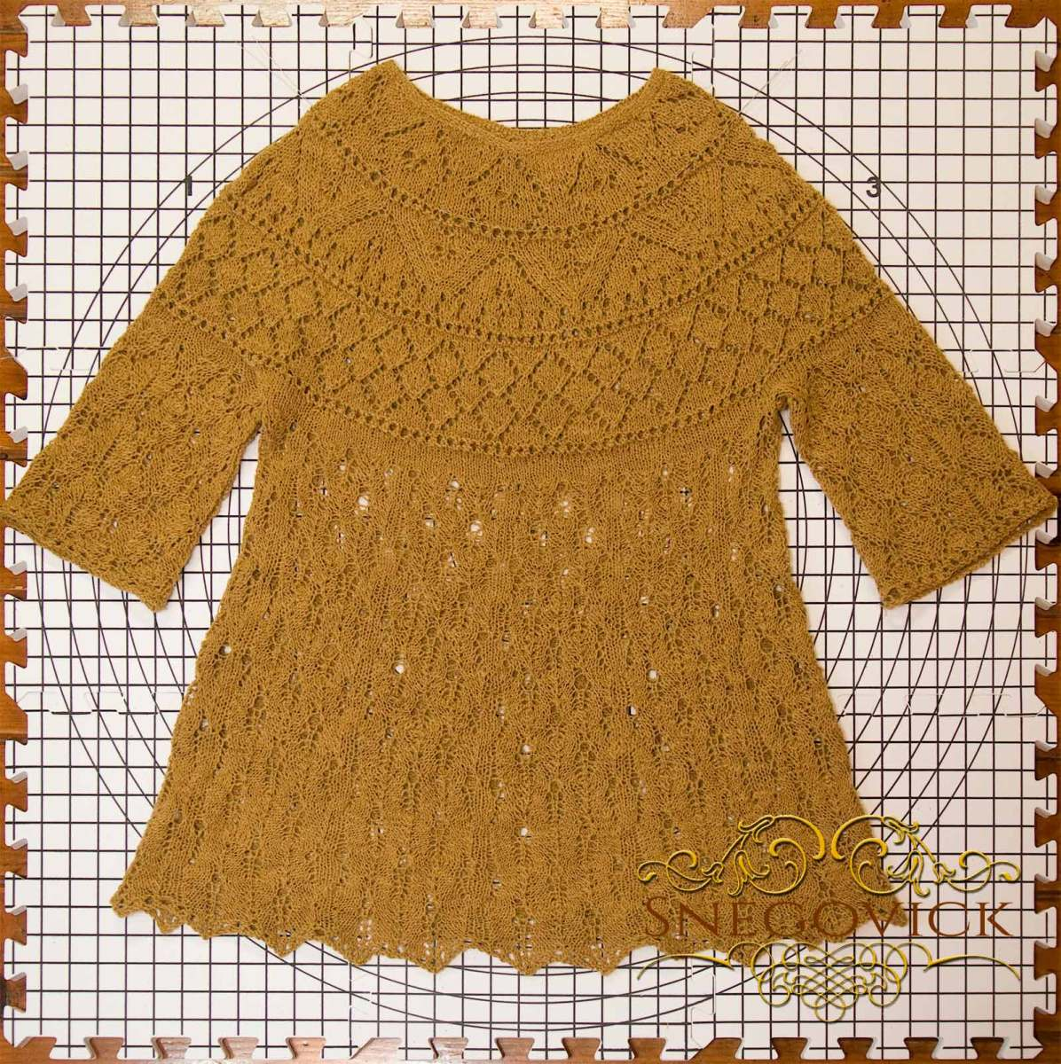 Finished hickory gossamer tunic on the blocking table.