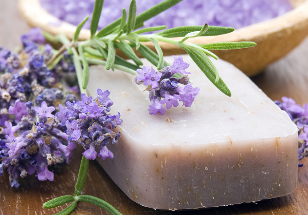 Homemade soap bar and lavender flowers