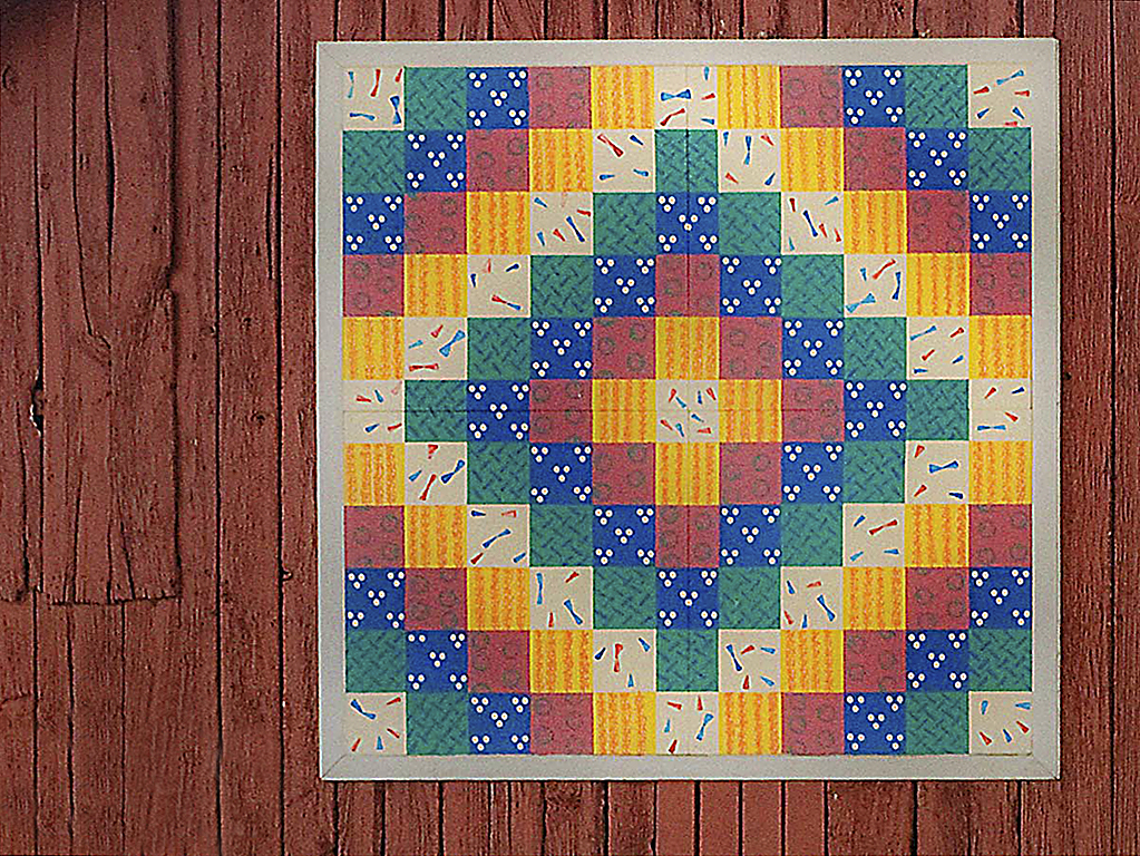 Sunrise and Shadow quilt pattern on a barn wall