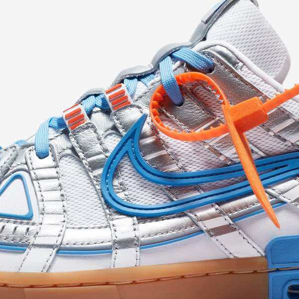 The Rubber Dunk x Off-White in Metallic Silver, orange, and University Blue.