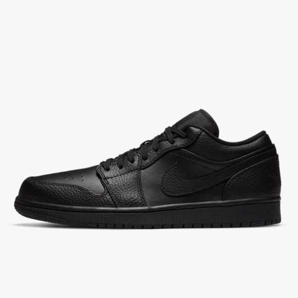 Air Jordan 1 Low Shoe in black, made with a combination of nubuck and full-grain leather materials.
