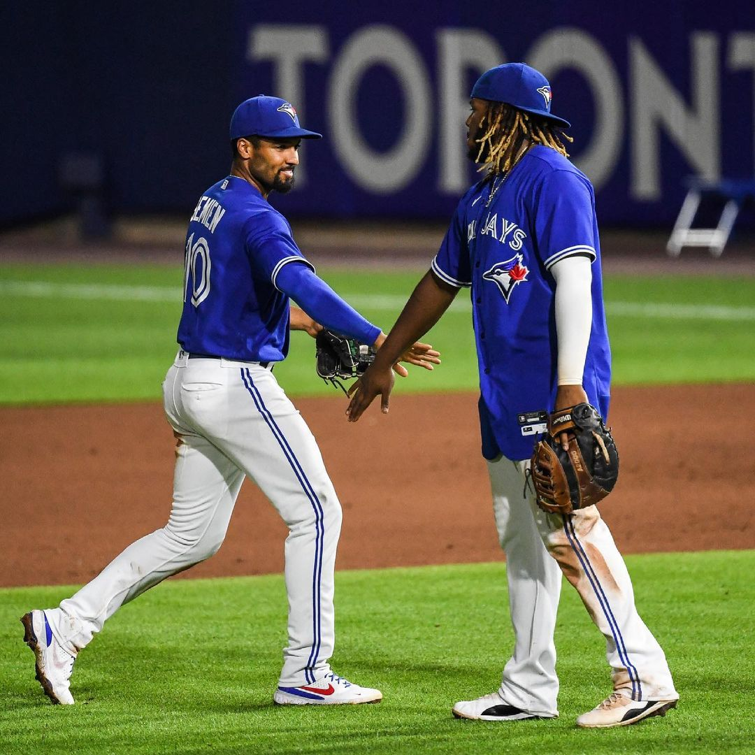 Toronto Blue Jays players low five one another during Tuesday's win