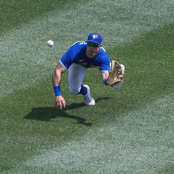 Blue Jays player Randal Grichuk lays out for a diving catch