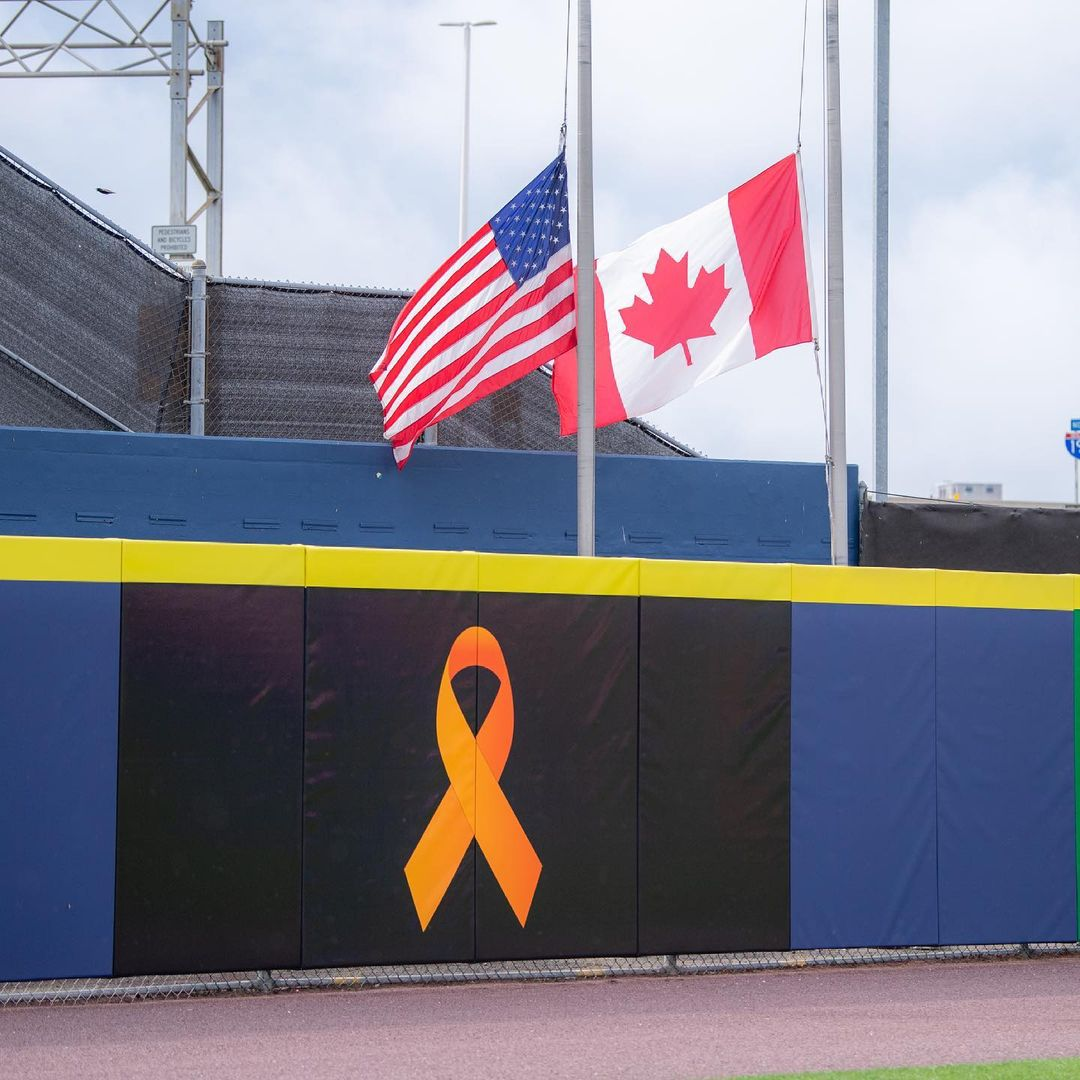 A symbol acknowledging the institutional murder of indigenous children is displayed at the Blue Jays game today