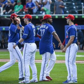 Blue Jays players celebrate their victory over the Tampa Bay Rays