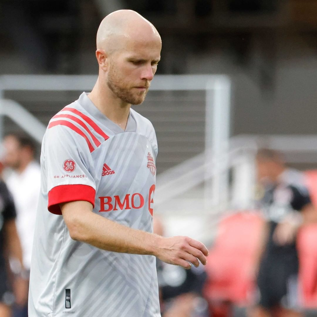 Toronto FC captain looks down dejectedly after a big loss against DC United