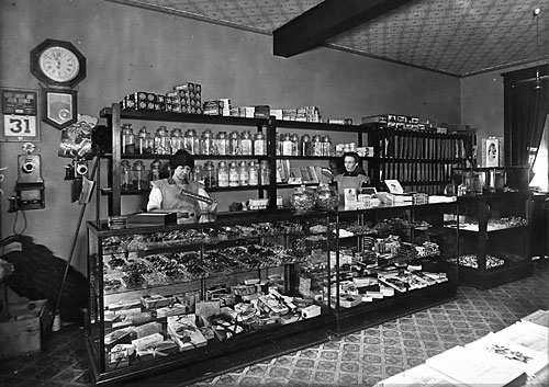Interior of the Kleisath Cand Store at 901 First Street sometime before 1918.  That's when the young clerk on the left, Florence Kleisath, married Earl Bailey and moved to the Bailey Farm that still exists south of town.