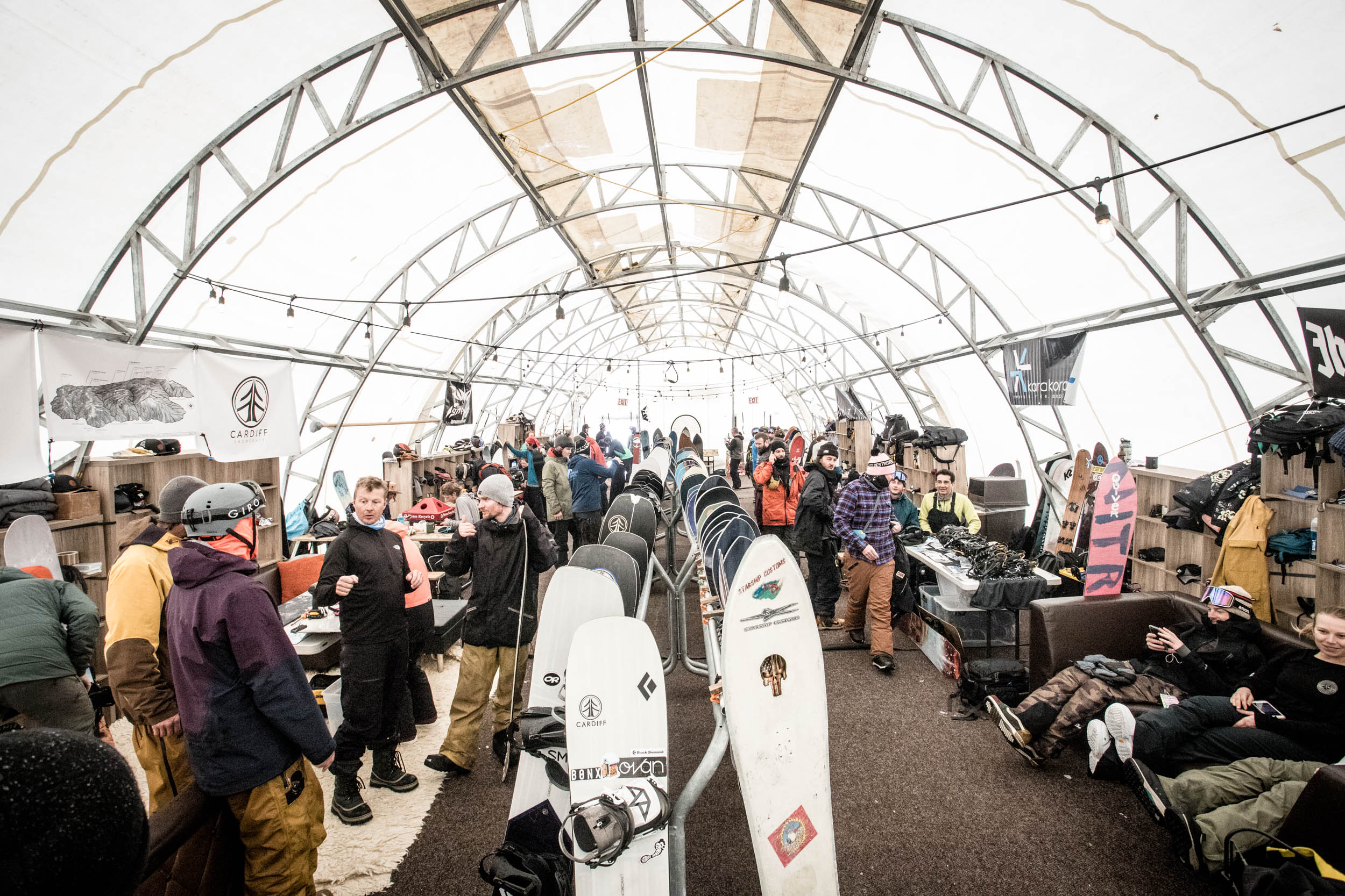 Hundreds of progressive board designs line the racks in the Shaper Summit tent for testers to choose from.. Click to view image.