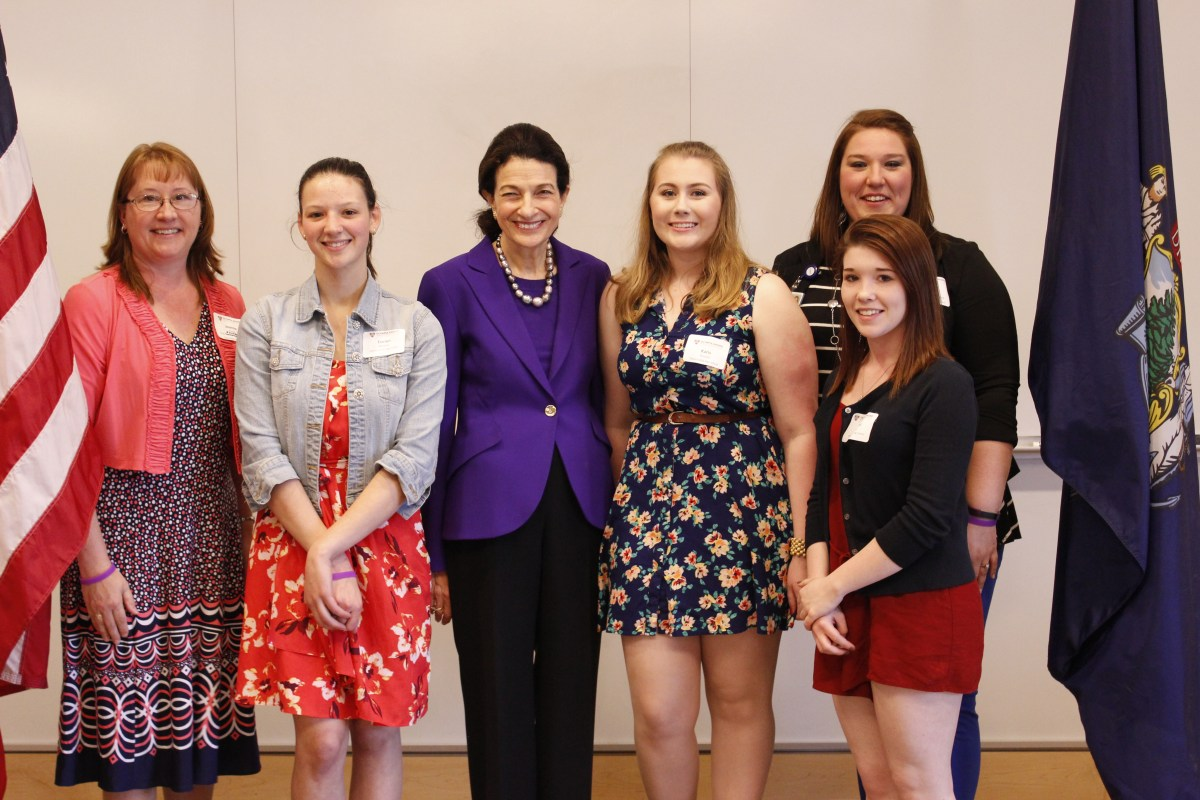 Olympia Snowe standing with students at event.
