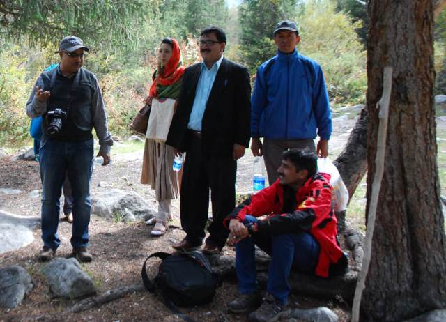Members of the Snow Leopard Trust's Pakistan team discussing with Science & Conservation Director Charu Mishra