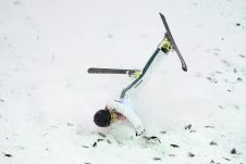 Lydia Lassila of Australia crashes on her final jump in the Women's Freestyle Aerials qualifier, at Phoenix Snow Park, during the PyeongChang 2018 Winter Olympic Games, in PyeongChang, South Korea, Thursday, February 15, 2018. (AAP Image/Dan Himbrechts)
