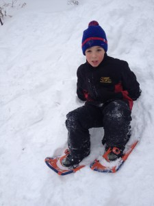 My oldest trying out his new snowshoes