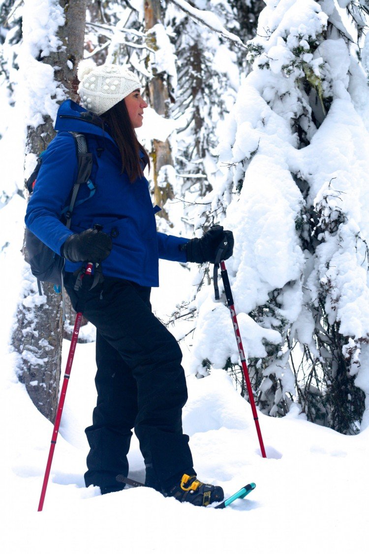 woman snowshoeing with poles