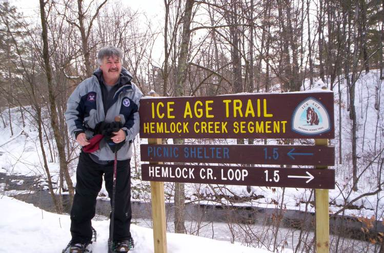 snowshoe Ice Age Trail: man with snowshoes near trail sign