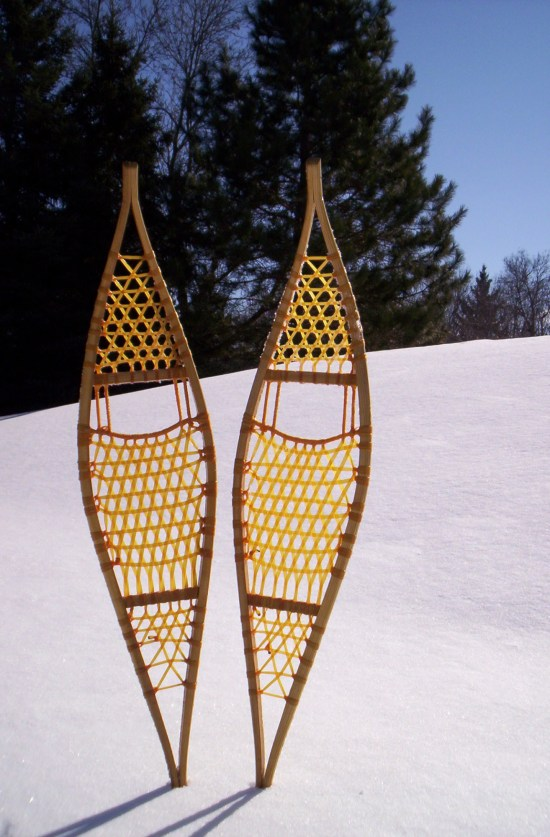 Ojibwa snowshoes sticking up in the snow