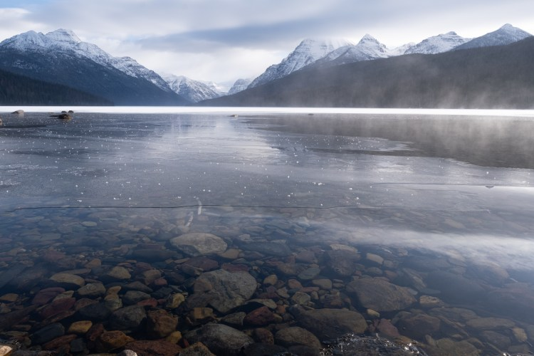 winter photo competition: hazy morning on lake with mountains