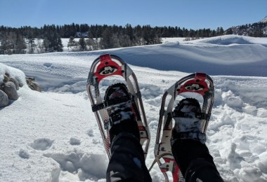 snowshoes while relaxing on snowshoe hike in Chama, NM