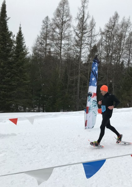 snowshoe racer crossing the finish line