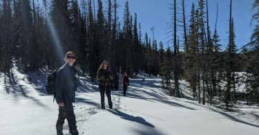 posing for a photo on the Meadows Trail to Zimmerman Lake