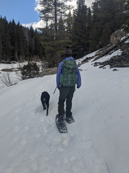 woman and dog snowshoeing with Lightning Ascents