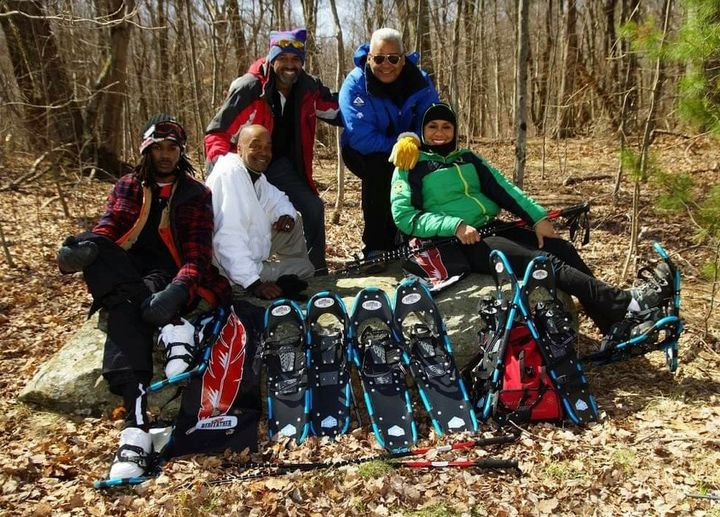 winter photo competition: group of people with snowshoes surrounded by leaves