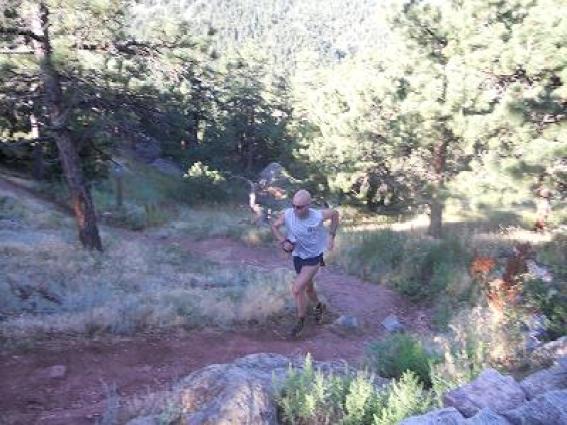man trail running in summer