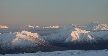 snow covered mountains and open sky in New Zealand