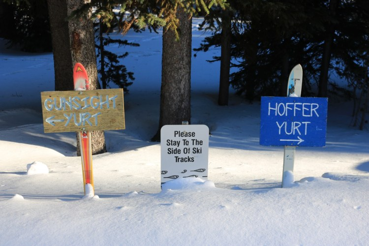 signs in the snow to huts and trails at Anthony Lakes Mountain Resort, OR