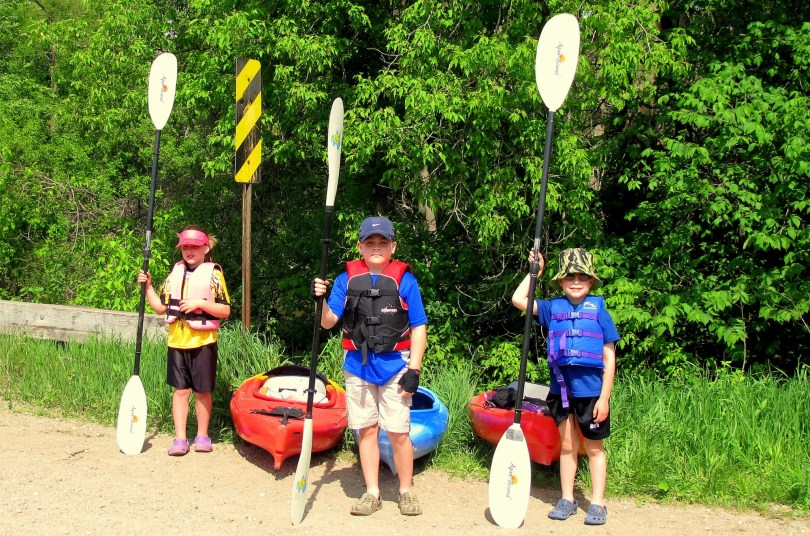 kids standing by kayaks for mothers day kayaking