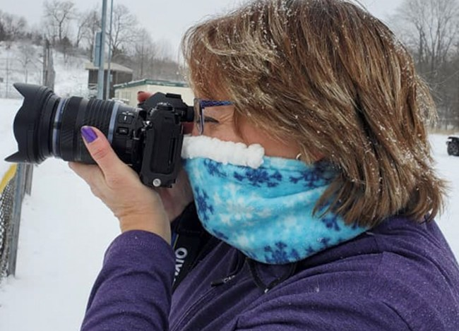 woman with camera wearing Cozy Nose