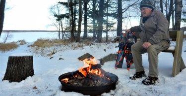 man at campfire in winter