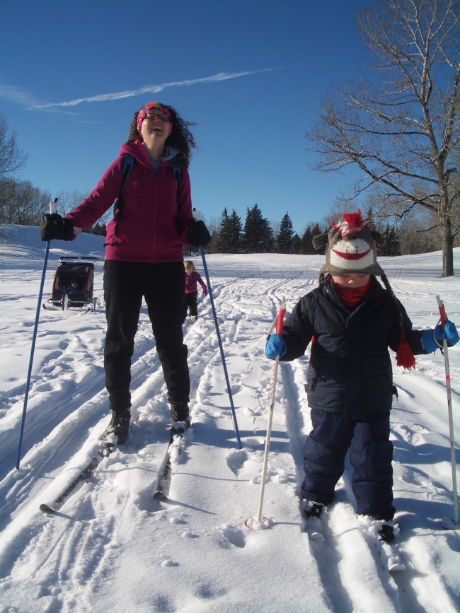 outdoor winter activities ideas: mom and son cross country skiing on a golf course