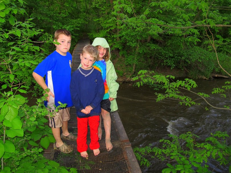 kids on footbridge after mothers day kayaking