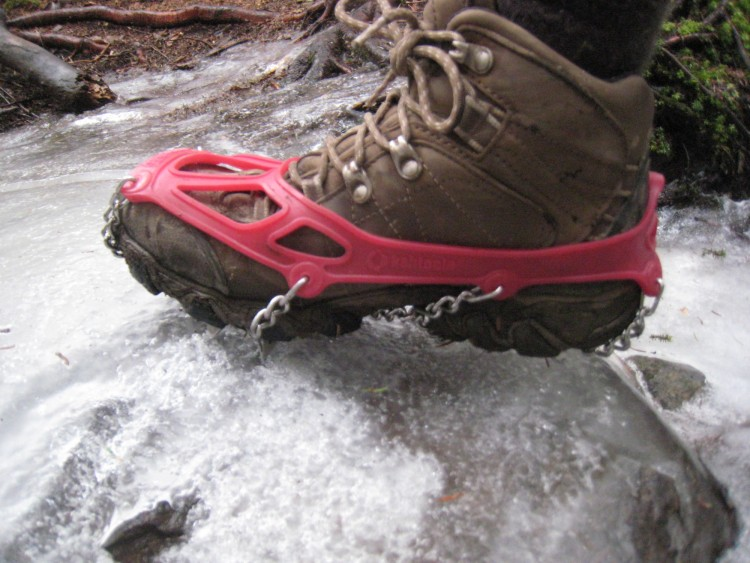 Kahtoola Microspikes: close up of foot with traction device on icy ground