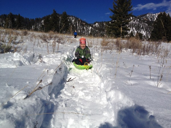 Use snowshoes to make a sledding track.